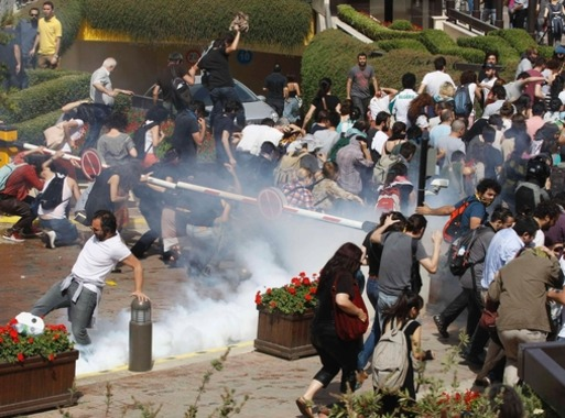 Turkish riot police use tear gas to disperse demonstrators during a protest against the destruction of trees in a park brought about by a pedestrian project, in Taksim Square in central Istanbul May 31, 2013. (Reuters)