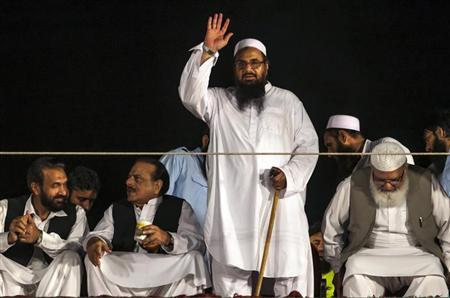 Saeed, head of the Jamaat-ud-Dawa organisation and founder of Lashkar-e-Taiba, waves to his supporters during a rally marking Pakistan's Defense Day in Islamabad