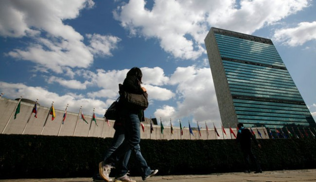 Tourists walk past the United Nations Headquarters in New York. Reuters  Mike Segar