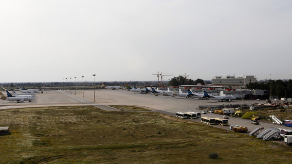 Airplanes are seen at the airport in Tripoli