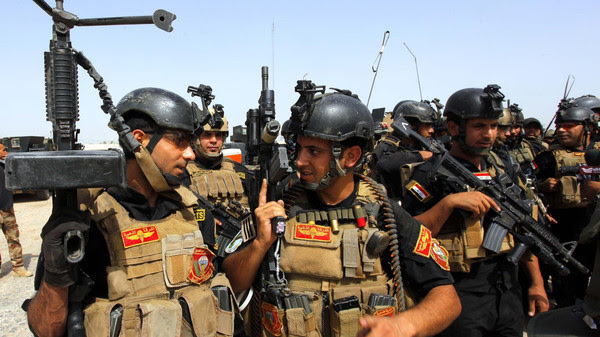 Members of the Iraqi Special Operations Forces (ISOF) prepare before going out on a patrol in the town of Jurf al-Sakhar