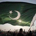 Pakistan-Flag-Lovers-A-man-waving-a-very-large-Pakistani-flag-Display-of-Pakistani-flag