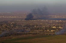 Smoke rises on both sides of the line dividing the Israeli-occupied Golan Heights from Syria during fighting near the Quneitra border crossing