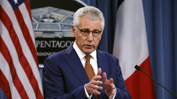 U.S. Secretary of Defense Hagel speaks during a joint news conference with French Minister of Defense Le Drian following their meeting at the Pentagon in Washington