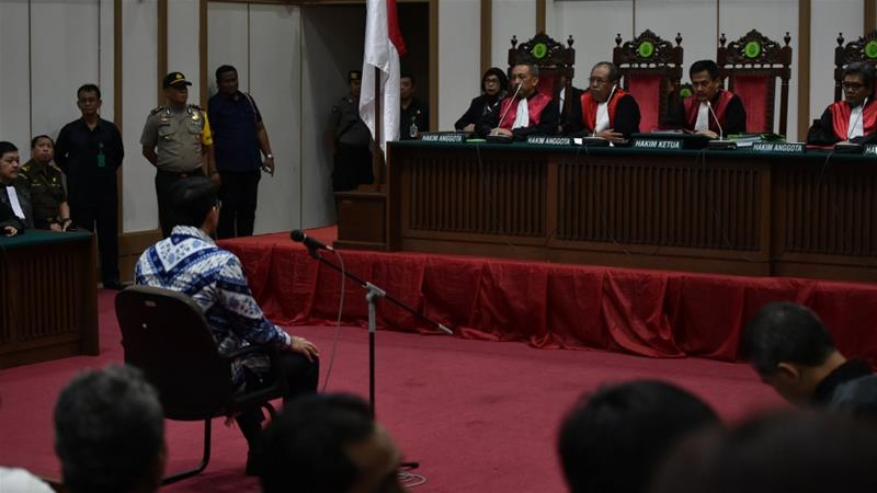 Court sentences Jakarta governor Ahok to two years jail for blasphemy
