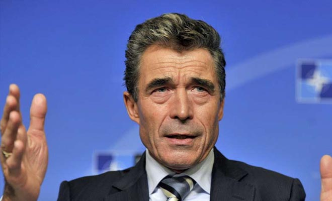 Nato Secretary General Anders Fogh Rasmussen gestures during his monthly press conference at the Residence Palace in Brussels. AFP Photo